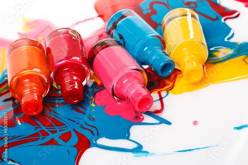 Fotografie, Obraz  Bottles with spilled nail polish