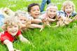 canvas print picture - lachende Kinder auf der Wiese