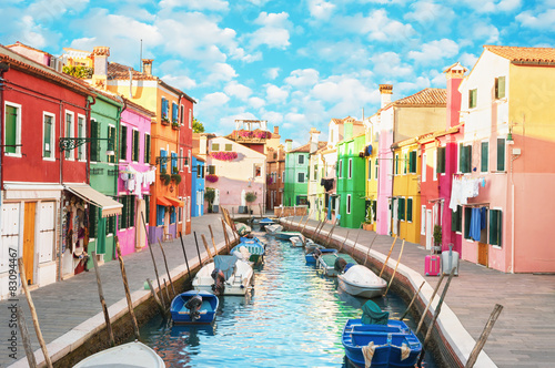 Narrow canal and colorful houses in Burano, Italy. Плакат