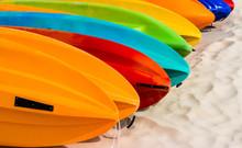 Kayaks Orderly Dock On A Beach