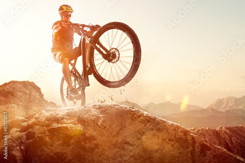 Printed kitchen splashbacks Cycling Mountainbiker performs a Wheelie