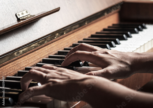 Close up of female hands playing piano Wallpaper Mural