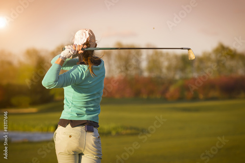 Spoed Foto op Canvas Golf Woman golf player hitting ball.