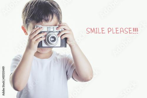 Poster  niño con cámara de fotos