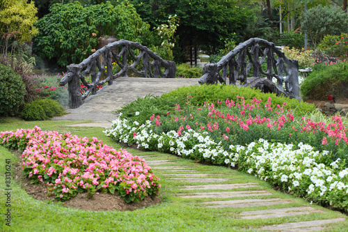 Papiers peints Jardin landscape of floral gardening with pathway and bridge in garden