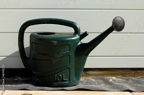 Fotografie, Obraz  Green Plastic Watering Can