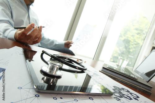 Spoed Foto op Canvas Zeilen Doctor working with digital tablet and laptop computer in medica