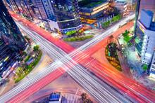 Korea Night View . Night Traffic Speeds Through An Intersection
