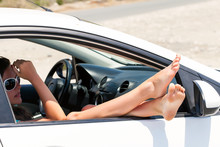Woman's Legs Dangling Out A Car