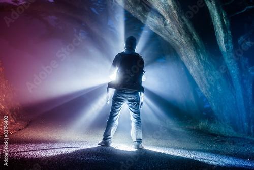 Obraz Backpacker with Flashlight - fototapety do salonu