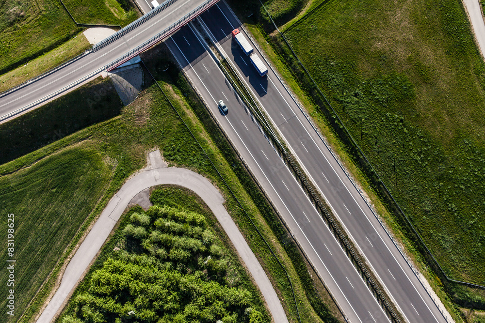 Fototapeta aerial view of highway and green harvest fields