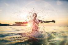 Man Having Fun Spashing Water