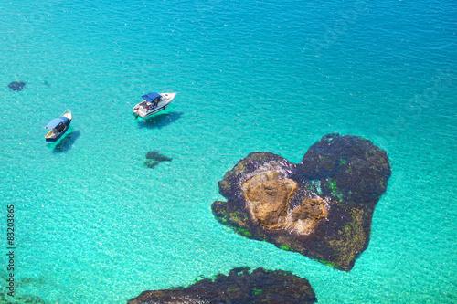 Spoed Foto op Canvas Eiland Romantic island the shape of heart. Honeymoon travel by boat.