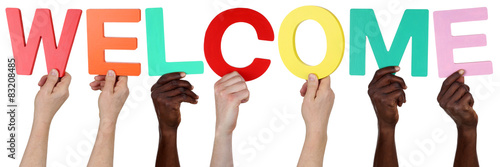 Fototapeta Multi ethnic group of people holding the word welcome