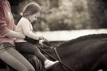 Little Girl Learning Horseback Riding