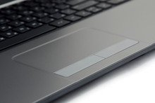 Close-up Touchpad And Keyboard Of The Notebook On White