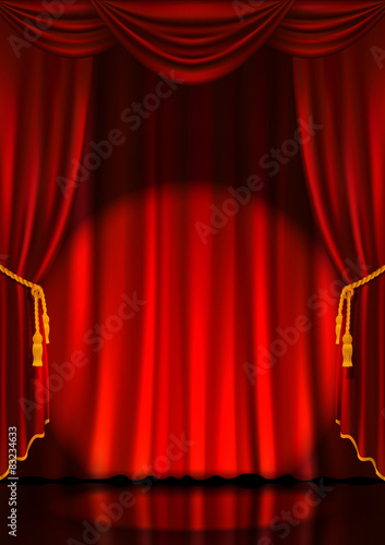 Fotografía  Theater stage with red curtains and spotlight.