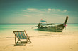 Exotic beach holiday background with beach chair and long tail b