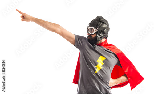 Super hero pointing to the lateral