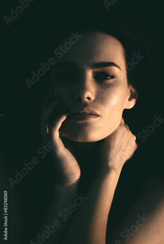 Dark portrait of a beautiful mysterious woman Canvas Print