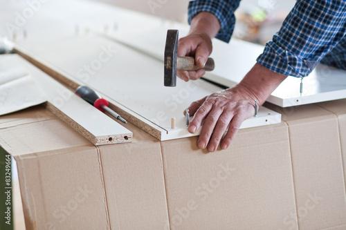 Photo  Man Assembling Flat Pack Furniture