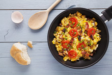 Scrambled Eggs In A Pan With B...