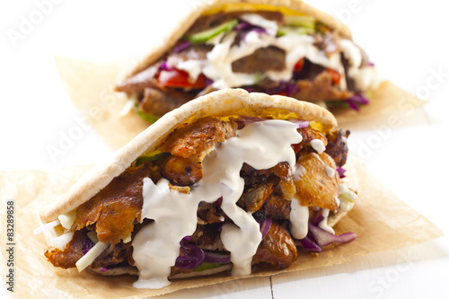 Kebab in a bun with garlic sauce