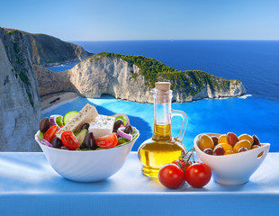 Obraz na Szkle Do jadalni Navagio beach with Greek salad in Zakynthos, Greece