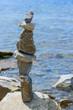 Cairn on the pebbly sea beach