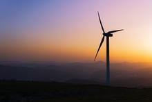 Wind Turbine Silhouette On Mou...
