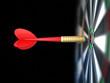Darts arrow in bull's-eye
