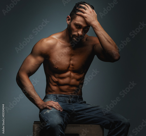 d1a473eb Muscular guy in blue jeans - Buy this stock photo and explore ...