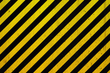 Concrete Wall With Black And Yellow Stripes