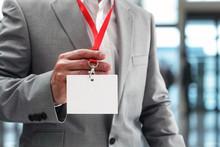 Businessman Holding Blank ID Badge