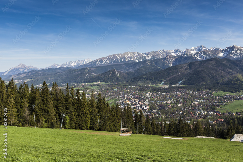 City of Zakopane and Tatras seen from the top of Gubalowka, emph