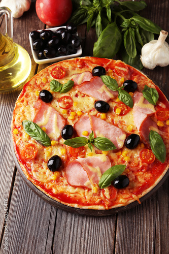 Delicious fresh pizza on brown wooden background Slika na platnu
