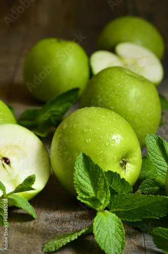 Green apples with mint leaves. © lilechka75