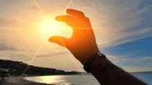 Sun And Hand