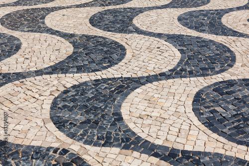 Foto op Plexiglas Cyprus Typical portuguese cobblestone hand-made pavement calçada in Li