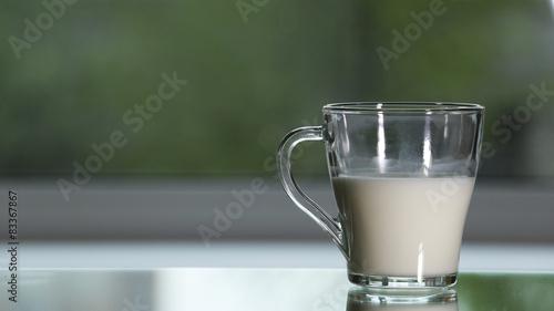 Milk, breastmilk,pour, shed,blur. Fototapet
