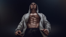 Confident Young Fitness Man With Strong Hands