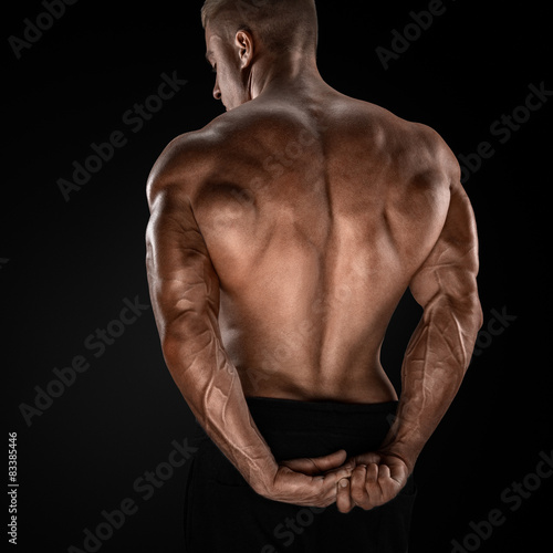 Handsome power bodybuilder showing his back Canvas Print