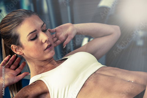 Wall Murals Equestrian Woman working out in fitness - Active girl in gym