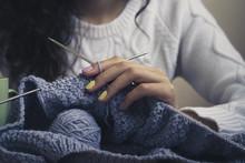 Blue Knitting In Female Hands Closeup