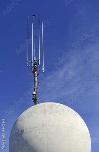 Fotografie, Tablou  Antenna on skyscraper with blue sky