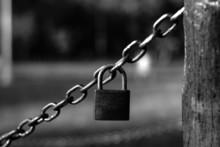 Closeup Photo Of Padlock Hanging On Chains