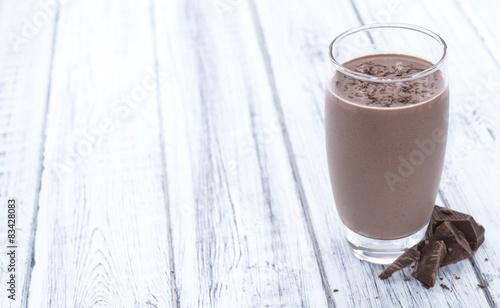 Foto op Aluminium Milkshake Chocolate Milk (on wooden background)