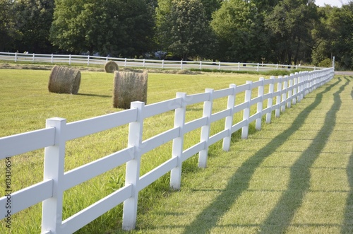 Fotografie, Obraz  White country fence boarding a pasture