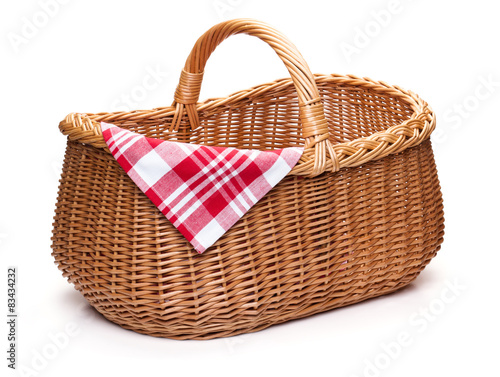 Fotografie, Obraz  Wicker picnic basket with red checked napkin.