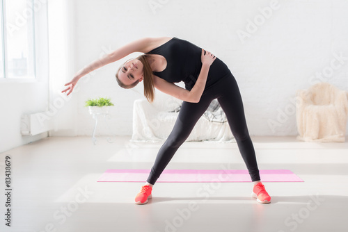 Fototapeta fitness slim girl doing yoga stretching exercise side body obraz